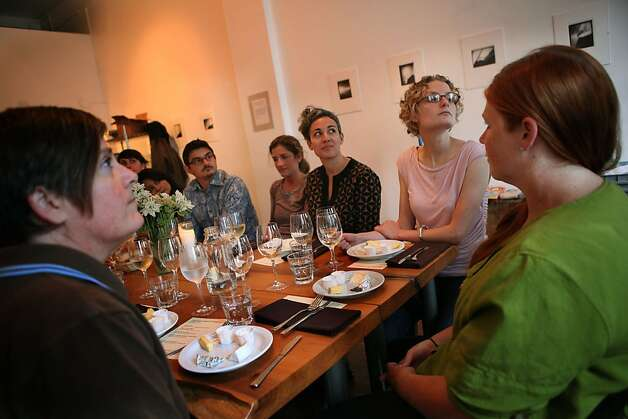 Clockwise from left--Shannon Wilson, Satarupa Bhattacharya, Kevin Neel, Leah Rosenberg, Sarah Robayo Sheridan, Bi-Ritecheese buyer Anthea Stolz, and Cowgirl Creamery salesperson Aislinn Muir listen to introductions during the producer dinner featuring Cowgirl Creamery cheeses at 18 Reasons in San Francisco, Calif., on Friday, August 19, 2011. Photo: Liz Hafalia, The Chronicle