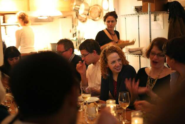 Sisters Sarah Baker (middle) and Shannon Baker (right), both from San Francisco, socialize during the producer dinner featuring Cowgirl Creamery cheeses at 18 Reasons in San Francisco, Calif., on Friday, August 19, 2011. Photo: Liz Hafalia, The Chronicle