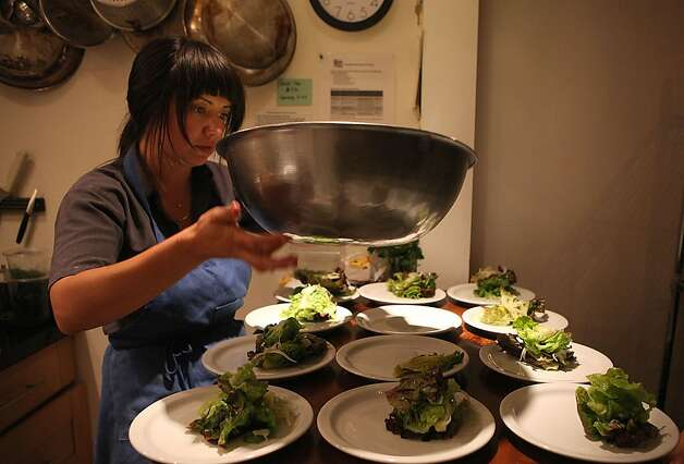 Vanessa Gonzalez of Bi-Rite plating salad for the producer dinner featuring Cowgirl Creamery cheeses at 18 Reasons in San Francisco, Calif., on Friday, August 19, 2011. Photo: Liz Hafalia, The Chronicle