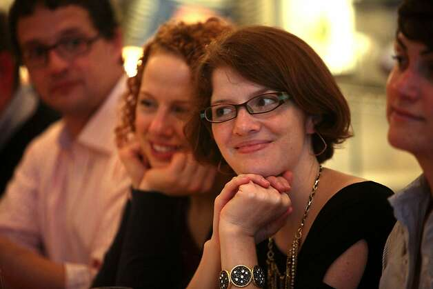 Sisters Sarah Baker (left) and Shannon Baker (right), both from San Francisco, listen to cheesemaker during the producer dinner featuring Cowgirl Creamery cheeses at 18 Reasons in San Francisco, Calif., on Friday, August 19, 2011. Photo: Liz Hafalia, The Chronicle