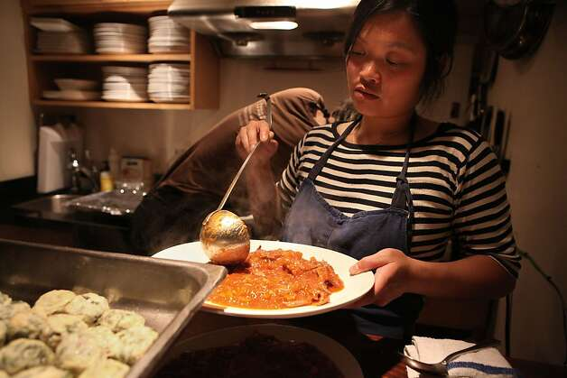 Head chef Linh Phu plating the duck sugo and roasted cherry tomatoes for the clabbered cottage cheese and chard gnudi for the producer dinner featuring Cowgirl Creamery cheeses at 18 Reasons in San Francisco, Calif., on Friday, August 19, 2011. Photo: Liz Hafalia, The Chronicle