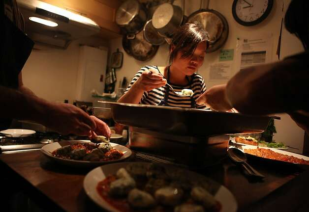 Head chef Linh Phu (middle) plating the duck sugo and roasted cherry tomatoes for the clabbered cottage cheese and chard gnudi for the producer dinner featuring Cowgirl Creamery cheeses at 18 Reasons in San Francisco, Calif., on Friday, August 19, 2011. Photo: Liz Hafalia, The Chronicle