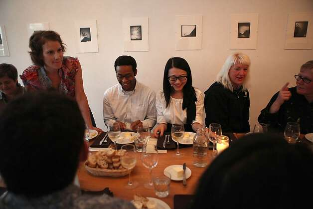 Cheesemaker Maureen Cunnie (left) talks about her cheeses as Derick McGee, Bonnie Ng (middle), smile at their cheese plates with Bi-Rite cheese supervisor Tammie Gilfoyle (right) and Debra Dickerson (far right) during the producer dinner featuring Cowgirl Creamery cheeses at 18 Reasons in San Francisco, Calif., on Friday, August 19, 2011. Photo: Liz Hafalia, The Chronicle