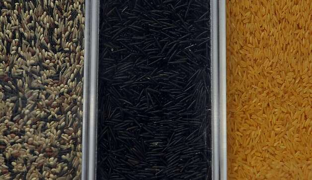 Variety of rice in their bins at Rainbow Grocery Cooperative in San Francisco, California, on Monday, September 19, 2011. Photo: Liz Hafalia, The Chronicle