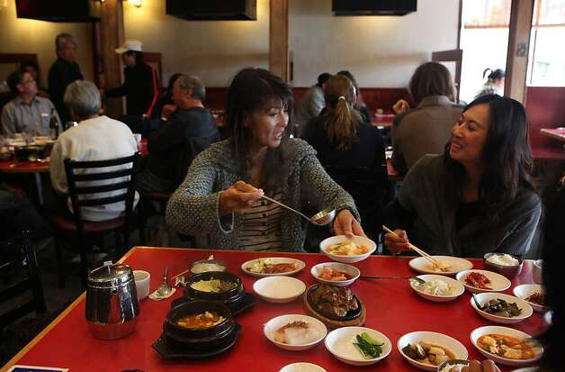 Janet Chang (left) having lunch with her friend Cameron Chang (right)  at Han Il Kwan, 1802 Balboa St. in San Francisco, California, on Monday, September 19, 2011. Photo: Liz Hafalia, The Chronicle