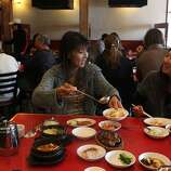 Janet Chang (left) having lunch with her friend Cameron Chang (right)  at Han Il Kwan, 1802 Balboa St. in San Francisco, California, on Monday, September 19, 2011.