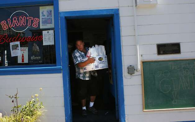 Robert Day from Petaluma carrrying out an order of 19 hamburgers from the Java House during a Giant's game in San Francisco, Calif.,  on Sunday, August 28, 2011. Photo: Liz Hafalia, The Chronicle
