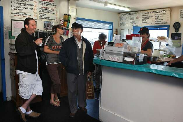 Outside chefs and friends of Java House employees Spencer O' Meara (left) and Sarah Burchard (middle, back) with Philip Papadopoulos (middle) and Maria Papadopoulos (behind counter) chatting with each other at the Java House during a Giant's game in San Francisco, Calif.,  on Sunday, August 28, 2011. Photo: Liz Hafalia, The Chronicle