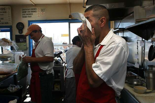 "Eddy ""Rambo"" Martinez bringing wiping his eyes behind the counter at the Java House just after the lunchtime rush before a Giant's game in San Francisco, Calif.,  on Sunday, August 28, 2011.  He also just brought in a bunch of onions. Photo: Liz Hafalia, The Chronicle"