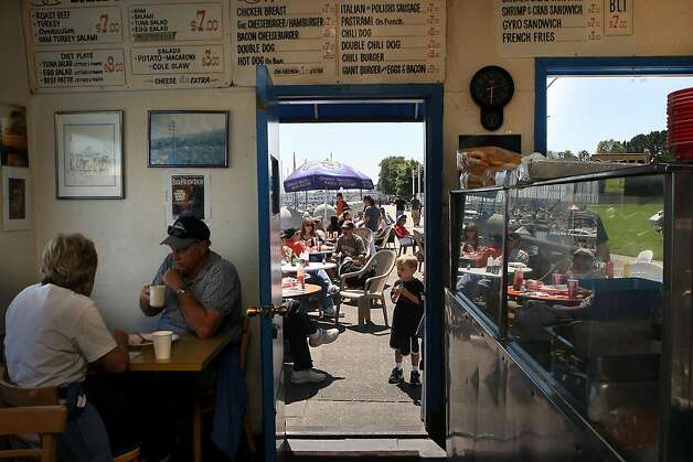 Patrons enjoying sunshine during the lunch hour at the Java House just before a Giant's game in San Francisco, Calif.,  on Sunday, August 28, 2011. Photo: Liz Hafalia, The Chronicle