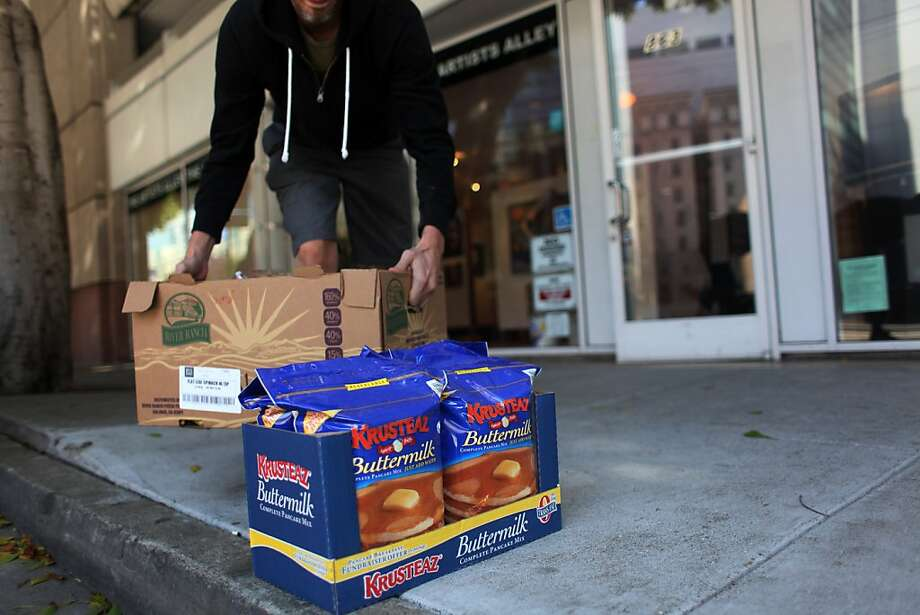 With the idea that a little goes a long way, Tom Kirlin, creator and coordinator of the the Pancakes and Booze art show, hauls in a modest amount of supplies hours before the show on Friday Sept. 16, 2011 in San Francisco, Calif. Photo: Mike Kepka, The Chronicle