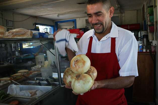 "Eddy ""Rambo"" Martinez bringing more onions behind the counter at the Java House just after the lunchtime rush before a Giant's game in San Francisco, Calif.,  on Sunday, August 28, 2011. Photo: Liz Hafalia, The Chronicle"