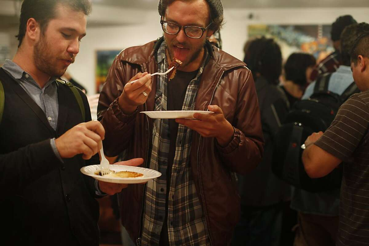 Jonas Johnson and Nick Parks chow down at the Pancakes and Booze art show on Friday Sept. 16, 2011 in San Francisco, Calif.