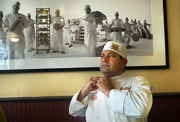 "Master baker Fernando Padilla fixing his jacket at Boudin Bakery on 10th Ave. in San Francisco, California, on Wednesday, September 14, 2011.  Fernando apprenticed with former Boudin owner ""Papa Steve"" Giraudo at 17 years old. Photo: Liz Hafalia, The Chronicle"