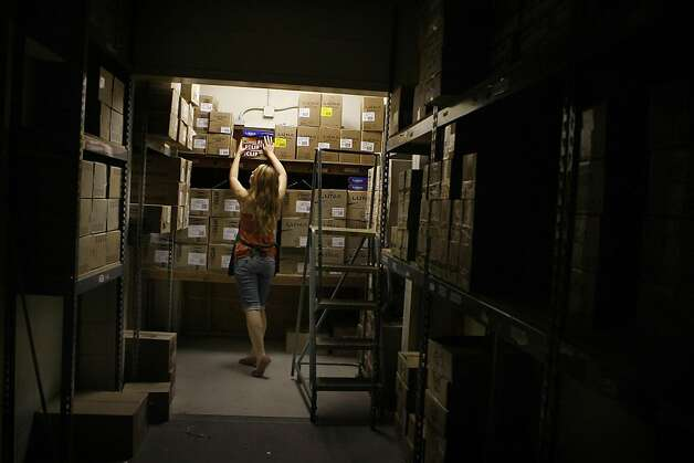 Anya Komisaryk getting boxes of Cliff and Luna bars from storage to restock the shelves at Sports Basement in San Francisco, California, on Saturday, September 17, 2011.  Sports Basement has the largest collection of nutritional sports bars. Photo: Liz Hafalia, The Chronicle