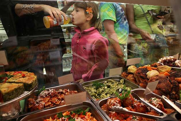 Margo Sinawi, 6 years old, gets a drink from her mother Michelle Donnelly as they wait for ravioli at Luca Deli during the lunch hour in San Francisco, Calif.,  on Tuesday, August 23, 2011.  Donnelly has been shopping at Luca Deli for 14 years. Photo: Liz Hafalia, The Chronicle