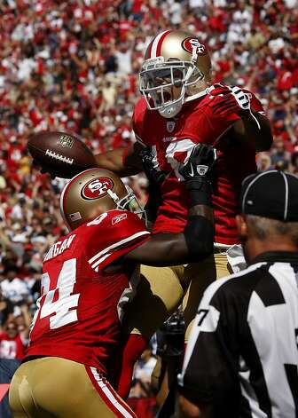 Kyle Williams (top) and Joshua Morgan celebrated Williams touchdown in the first half. San Francisco 49ers lose to the Dallas Cowboys in overtime 27-24 at Candlestick Park Sunday September 18, 2011. Photo: Brant Ward, The Chronicle