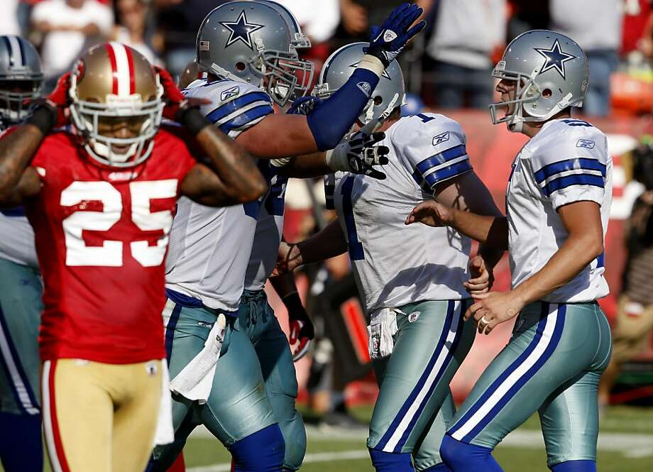Dallas kicker Dan Bailey (right) celebrates his game winning field goal as Tarell Brown (left) walks off the field. San Francisco 49ers lose to the Dallas Cowboys in overtime 27-24 at Candlestick Park Sunday September 18, 2011. Photo: Brant Ward, The Chronicle