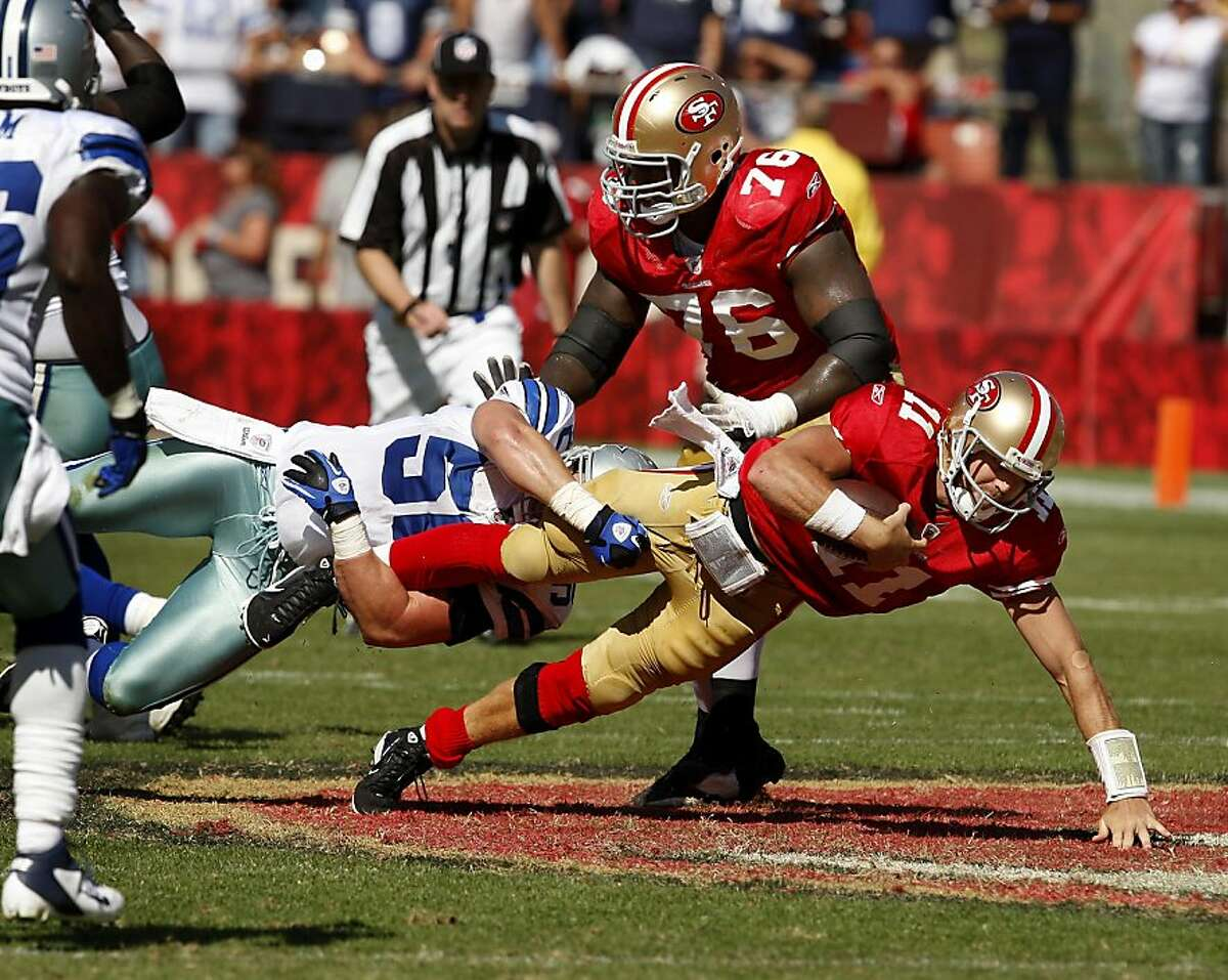 Alex Smith takes off on a keeper in the first half. San Francisco 49ers lose to the Dallas Cowboys in overtime 27-24 at Candlestick Park Sunday September 18, 2011.