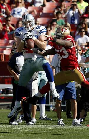 NaVorro Bowman tries to break up a pass to John Phillips of the Cowboys in the first half. San Francisco 49ers lose to the Dallas Cowboys in overtime 27-24 at Candlestick Park Sunday September 18, 2011. Photo: Brant Ward, The Chronicle