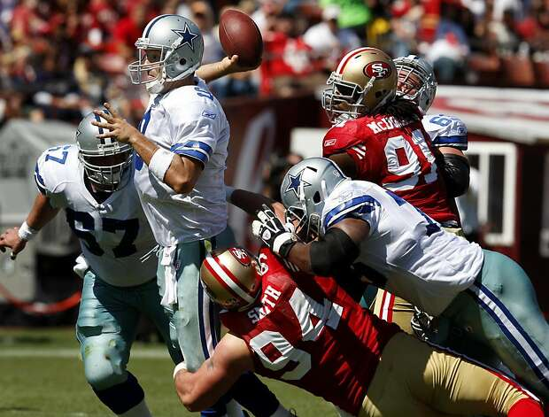 Tony Romo faces some pressure from the 49ers in the first half. San Francisco 49ers lose to the Dallas Cowboys in overtime 27-24 at Candlestick Park Sunday September 18, 2011. Photo: Brant Ward, The Chronicle