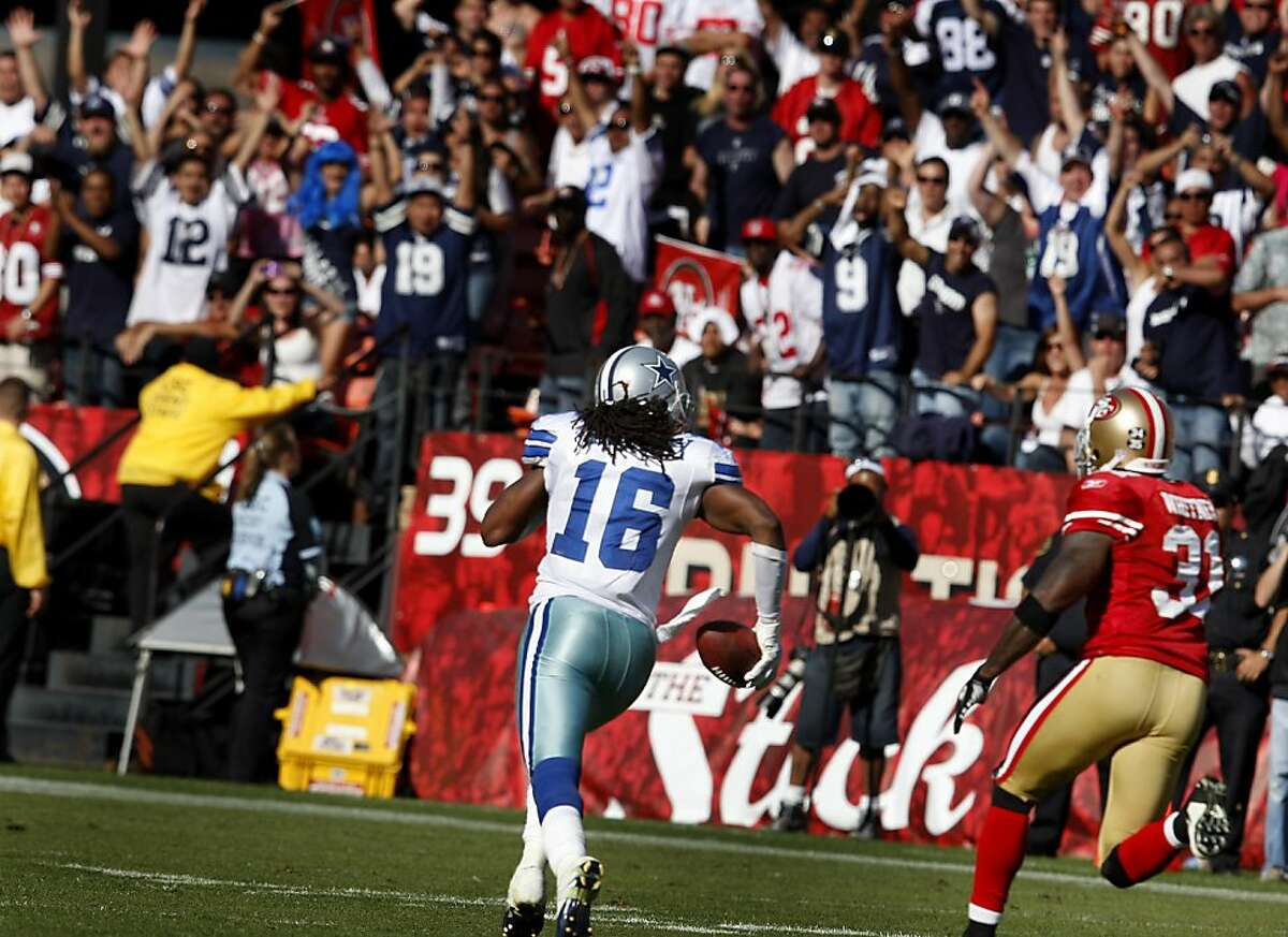 Dallas fans go crazy as Jesse Holley (16) goes down to the one yardline to set up an easy field goal and overtime victory for Dallas. San Francisco 49ers lose to the Dallas Cowboys in overtime 27-24 at Candlestick Park Sunday September 18, 2011.