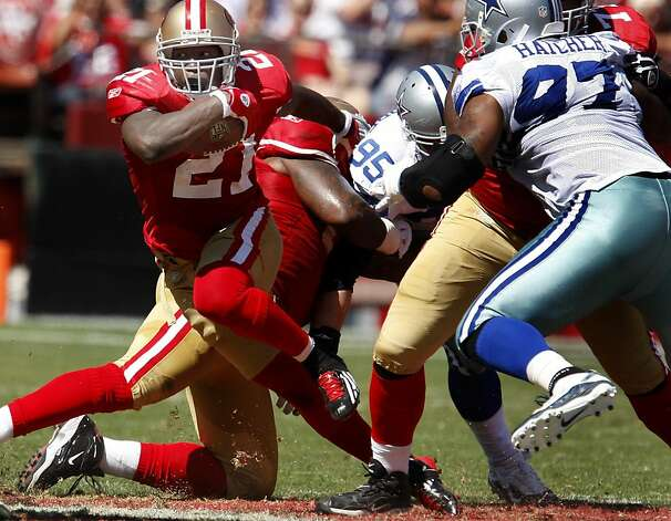 Frank Gore gets off a nice run in the first half. San Francisco 49ers lose to the Dallas Cowboys in overtime 27-24 at Candlestick Park Sunday September 18, 2011. Photo: Brant Ward, The Chronicle