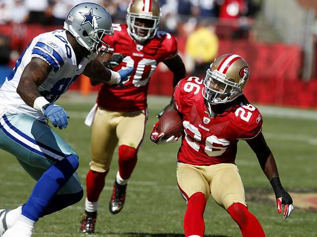 Cornerback Tramaine Brock returns an interception. San Francisco 49ers lose to the Dallas Cowboys in overtime 27-24 at Candlestick Park Sunday September 18, 2011. Photo: Brant Ward, The Chronicle