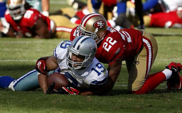Miles Austin of the Cowboys is tackled by Carlos Rogers on a pass play in overtime. San Francisco 49ers lose to the Dallas Cowboys in overtime 27-24 at Candlestick Park Sunday September 18, 2011. Photo: Brant Ward, The Chronicle