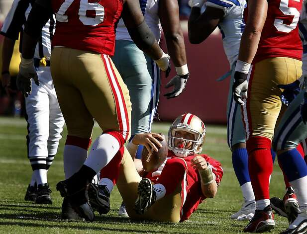 Alex Smith gets helped up after being sacked in the second half. San Francisco 49ers lose to the Dallas Cowboys in overtime 27-24 at Candlestick Park Sunday September 18, 2011. Photo: Brant Ward, The Chronicle