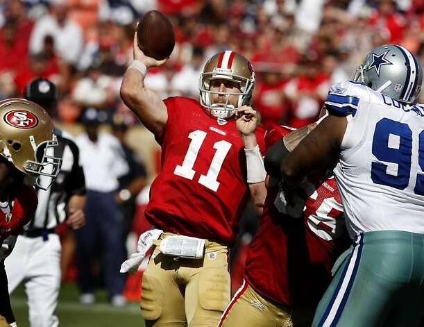 Alex Smith throws an incomplete pass under pressure in the first half. San Francisco 49ers lose to the Dallas Cowboys in overtime 27-24 at Candlestick Park Sunday September 18, 2011. Photo: Brant Ward, The Chronicle