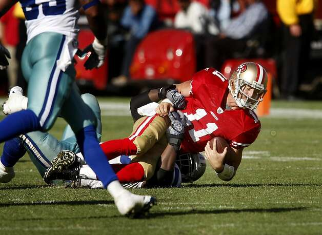 Alex Smith gets sacked in overtime. San Francisco 49ers lose to the Dallas Cowboys in overtime 27-24 at Candlestick Park Sunday September 18, 2011. Photo: Brant Ward, The Chronicle