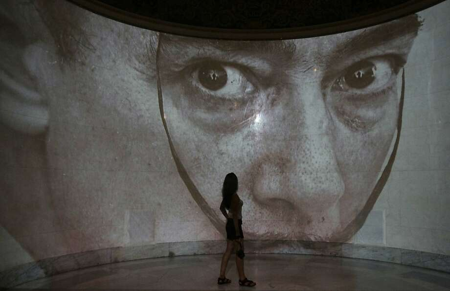 A visitor looks at part of the Salvador Dali in Moscow exhibition at the Pushkin Art Museum in Moscow, Russia, Friday, Sept. 2, 2011. (AP Photo/Misha Japaridze) Photo: Misha Japaridze, AP