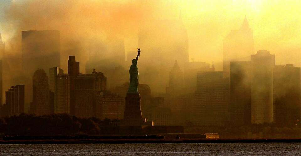 The Statue of Liberty is seen at first light in this view from Jersey City, N.J., against a smoke-fi
