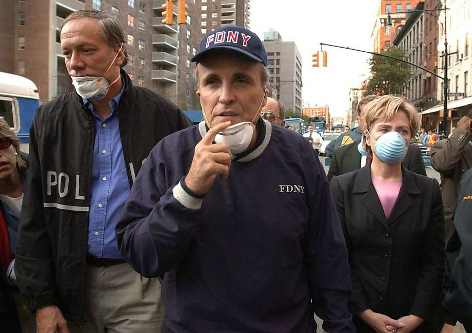 New York Governor George Pataki (L), New York City Mayor Rudolph Giuliani (C) and US Senator Hillary Rodham Clinton (R), D-NY, tour the site of the World Trade Center disaster on Sept. 12, 2001.  Photo: Robert F. Bukaty, AFP/Getty Images