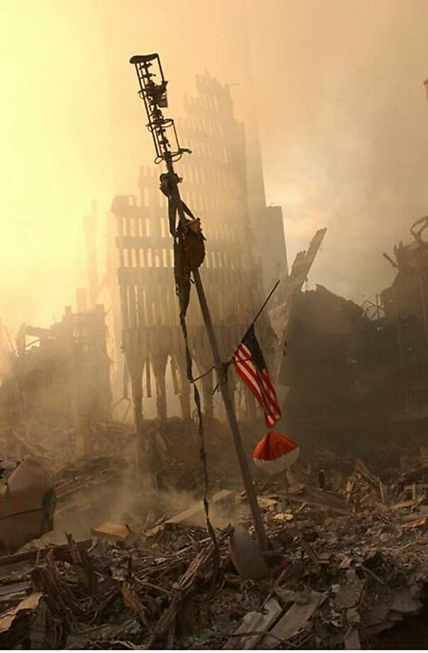 A US flag flies from a television antenna Sept. 13, 2001 amid the rubble of the World Trade Center. The antenna was once at the top of one of the 110 story twin towers.  Photo: Fema