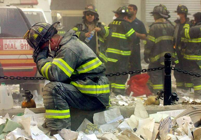 A firefighter breaks down after the World Trade Center buildings collapsed Sept. 11, 2001.