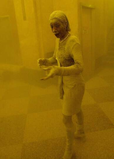 Marcy Borders is covered in dust as she takes refuge in an office building after one of the World Tr