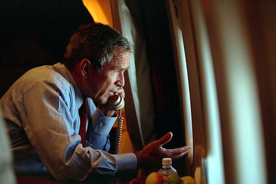 President George W. Bush speaks to Vice President Dick Cheney by phone aboard Air Force One Sept. 11, 2001 after departing Offutt Air Force Base in Nebraska. Photo: The White House