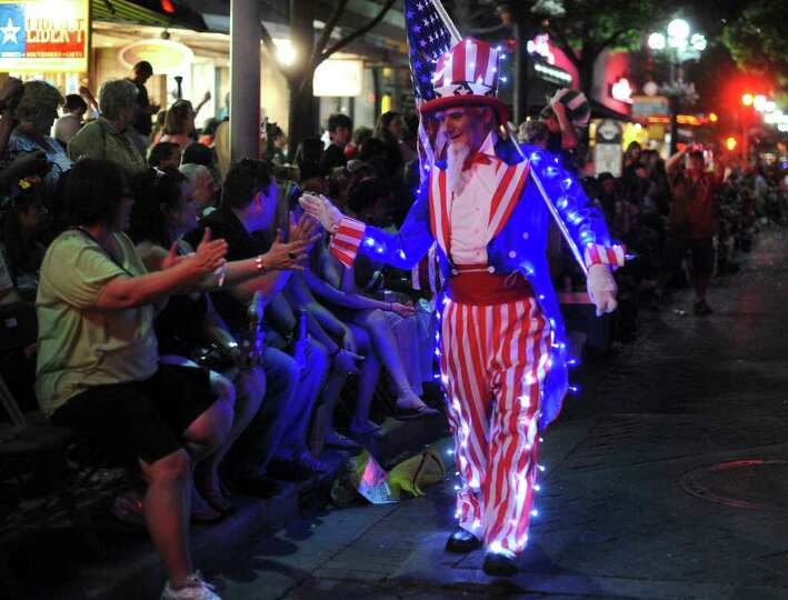 Ian Parkes, an immigrant from England, proudly wears the colors of the USA during the Fiesta Flambea