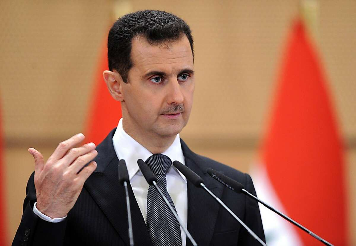 """In this photo released by the Syrian official news agency SANA, Syria's President, Bashar Assad delivers a speech in Damascus, Syria, Monday, June 20, 2011. Syria's embattled president says """"saboteurs"""" are trying to exploit legitimate demands for reform in the country. President Bashar Assad's speech Monday was only his third public address since the country's uprising began in March. What is happening today has nothing to do with reform, it has to do with vandalism,"""" Assad told a crowd of supporters at Damascus University. (AP Photo/SANA) EDITORIAL USE ONLY Ran on: 06-21-2011 Bashar Assad addresses a crowd of supporters at Damascus University. Ran on: 06-26-2011 Syria's president, Bashar Assad, can find an example of the effect of his policies in Belarus. Ran on: 06-26-2011 Syria's president, Bashar Assad, can find an example of the effect of his policies in Belarus."""