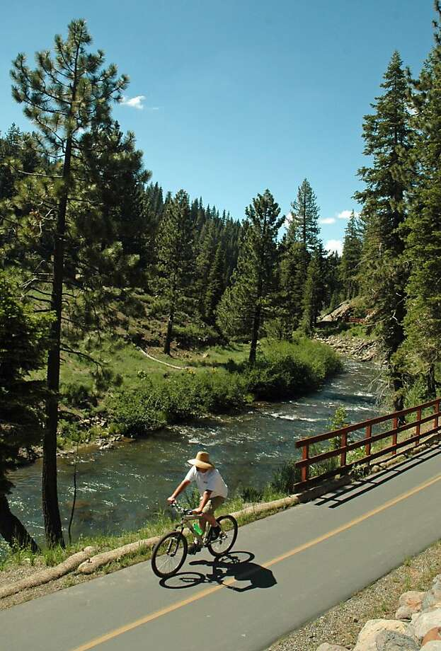 A biker rides takes advantage of the wide paved bike trails in North Lake Tahoe. Photo: Bill Fink, Special To The Chronicle
