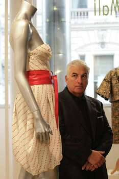 Mitch Winehouse with his late daughter Amy Winehouse's dress - a printed chiffon dress by the designer Disaya and worn by her for the cover of her 'Back to Black' album in 2006 - during a press preview for the 'Passion for Fashion' auction,  in central London Monday Nov.28, 2011.  The dress sold on Tuesday Nov. 29 for over 43,000 pounds ($67, 120)  to a Chilean  fashion museum.  (AP Photo /Yui Mok/PA ) UNITED KINGDOM OUT  NO SALES  NO ARCHIVE Photo: Yui Mok / PA