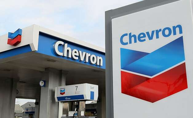 ALAMEDA, CA - JANUARY 29:  The Chevron logo is displayed at a Chevron gas station January 29, 2010 in Alameda, California. Chevron reported a 37 percent decline in fourth quarter profits with earnings of $3.07 billion, or $1.53 a share compared to $4.9 billion, or $2.44 a share, a year ago. (Photo by Justin Sullivan/Getty Images)  Ran on: 01-30-2010 Photo caption Dummy text goes here. Dummy text goes here. Dummy text goes here. Dummy text goes here. Dummy text goes here. Dummy text goes here. Dummy text goes here. Dummy text goes here.###Photo: chevron30_PH21264636800Getty Images North America###Live Caption:ALAMEDA, CA - JANUARY 29:  The Chevron logo is displayed at a Chevron gas station January 29, 2010 in Alameda, California. Chevron reported a 37 percent decline in fourth quarter profits with earnings of $3.07 billion, or $1.53 a share compared to $4.9 billion, or $2.44 a share, a year ago.###Caption History:ALAMEDA, CA - JANUARY 29:  The Chevron logo is displayed at a Chevron gas station January 29, 2010 in Alameda, California. Chevron reported a 37 percent decline in fourth quarter profits with earnings of $3.07 billion, or $1.53 a share compared to $4.9 billion, or $2.44 a share, a year ago. (Photo by Justin Sullivan-Getty Images)###Notes:Chevron's Quarterly Profits Slide 37 Percent###Special Instructions:  Ran on: 04-04-2010 Photo caption Dummy text goes here. Dummy text goes here. Dummy text goes here. Dummy text goes here. Dummy text goes here. Dummy text goes here. Dummy text goes here. Dummy text goes here.###Photo: BB_Brief04_PH11264636800Getty Images North America###Live Caption:ALAMEDA, CA - JANUARY 29:  The Chevron logo is displayed at a Chevron gas station January 29, 2010 in Alameda, California. Chevron reported a 37 percent decline in fourth quarter profits with earnings of $3.07 billion, or $1.53 a sh Photo: Justin Sullivan, Getty Images
