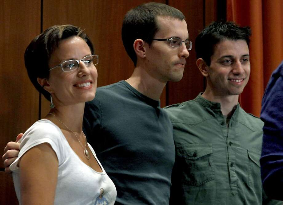 From left, Sarah Shourd, Shane Bauer, and Josh Fattal, stand together after a news conference on Sunday, Sept. 25, 2011 in New York.    Fattal and Bauer, both 29, were freed last week under a $1 million bail deal and arrived Wednesday in Oman, greeted by relatives and fellow hiker Shourd, who was released last year.   The two American hikers held for more than two years in an Iranian prison.   (AP Photo/Craig Ruttle) Photo: Craig Ruttle, AP