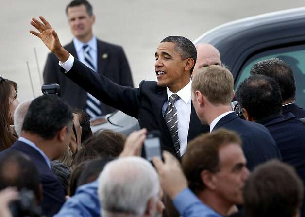 President Obama waves to the crowd as he finishes shaking hands. President Barack Obama arrived at Moffett Field in Mountain View, Calif. Sunday September 25, 2011 for a series of fundraisers and meetings. Photo: Brant Ward, The Chronicle