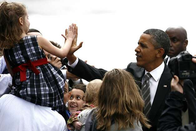 President Barack Obama greets supporters after disembarking Air Force One at Boeing Field Sunday, Sept. 25, 2011, in Seattle. (AP Photo/Joe Nicholson) Photo: Joe Nicholson, AP