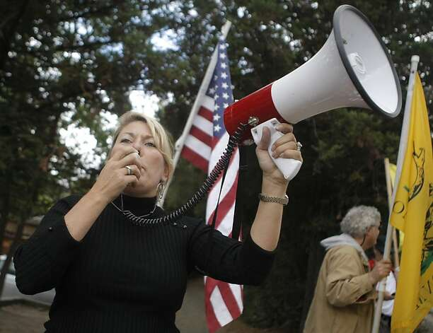 Heather Gass, a Tea Party activist, uses a bullhorn to lead a protest in Woodside, Calif., on Sunday, Sept. 25, 2011.  The President is in the area doing a fundraiser. Photo: Dylan Entelis, The Chronicle