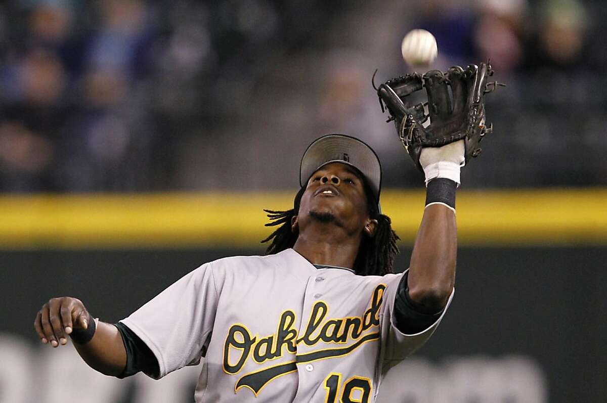Oakland Athletics second baseman Jemile Weeks catches a pop-up from Seattle Mariners' Luis Rodriguez in the sixth inning of a baseball game, Monday, Sept. 26, 2011, in Seattle. (AP Photo/Elaine Thompson)