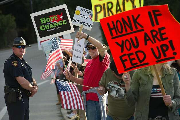 Bob Simmons of Los Altos, center, joins other members of the TEA party as they protest President Obama's arrival to a fund raising dinner on September 25, 2011 in Woodside, Calif. Photo: David Paul Morris, Special To The Chronicle